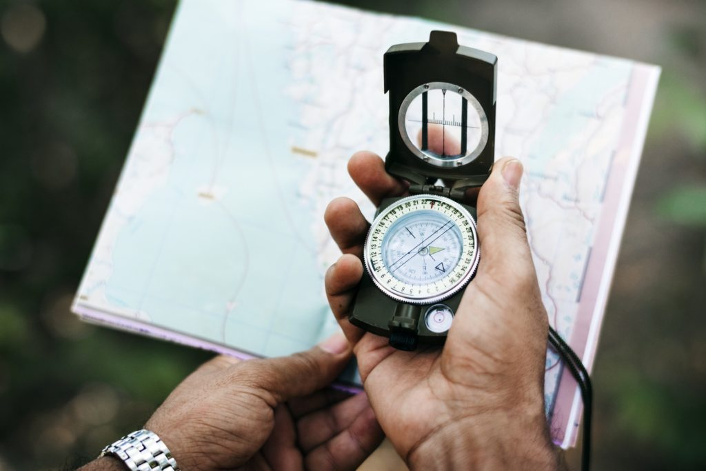 Man looking at map and compass - survival team building