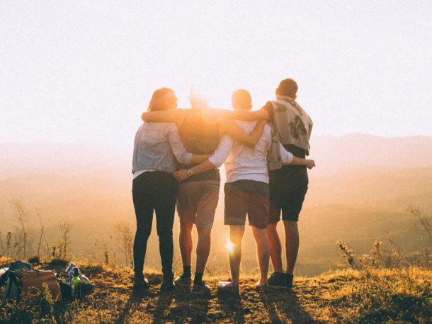 4 people watching the sun set