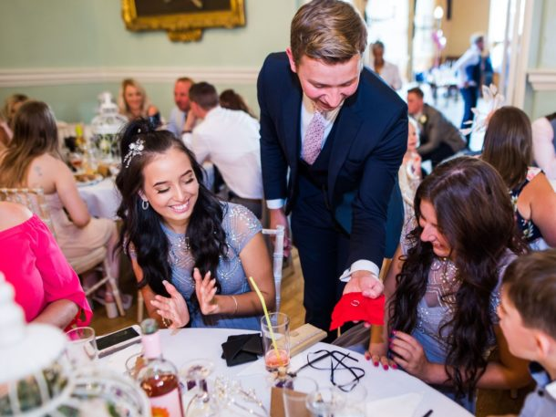 Magician wowing guests at an event - Right Angle Corporate Events