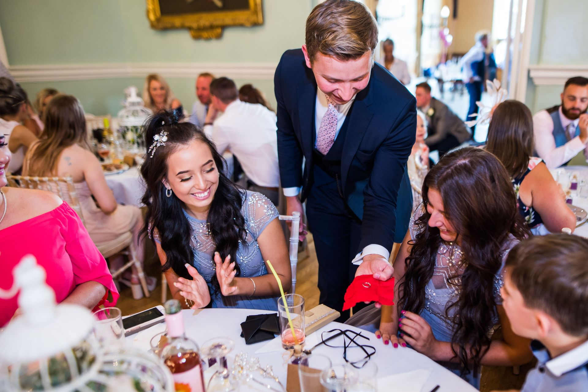 Magician wowing guests at a wedding